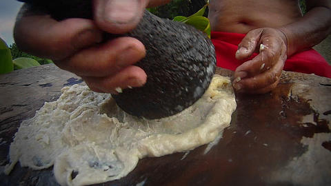 Poi paste is ground on a pestle ion hawaii Stock Video Footage