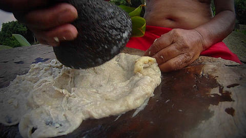 Poi paste is ground on a pestle ion hawaii Footage
