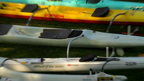 Empty kayaks sit on a beach Stock Video Footage
