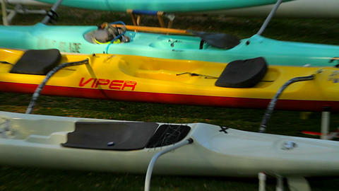 Empty kayaks sit on a beach Footage