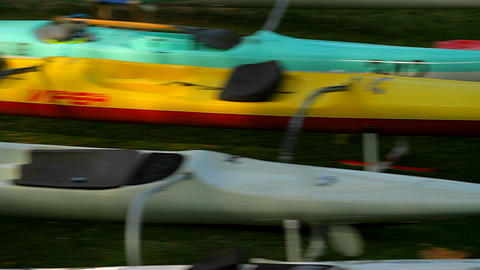 Empty kayaks sit on a beach Stock Video Footage