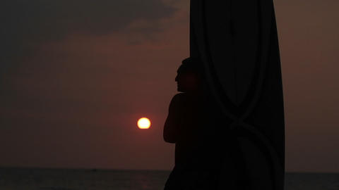 A man looks out over the ocean in Hawaii Stock Video Footage