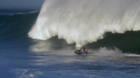 A jet skier braves huge waves in Hawaii Stock Video Footage