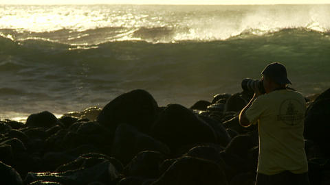 A photographer follows large waves as they crest a Footage
