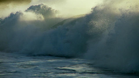 Large waves as they crest and break in slow motion Stock Video Footage