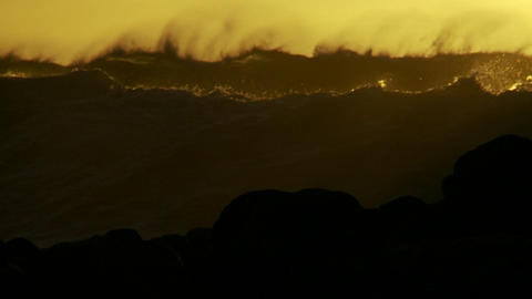 Large orange and black waves as they crest and bre Stock Video Footage