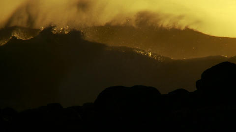 Large orange and black waves as they crest and bre Footage