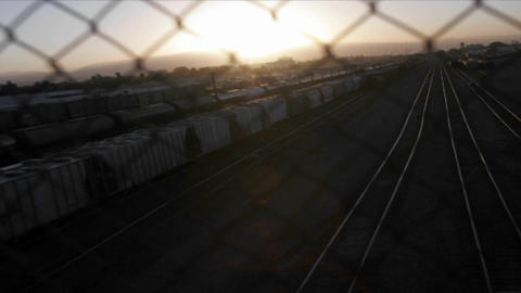 A time lapse shot through a chain link fence of a railway... Stock Video Footage