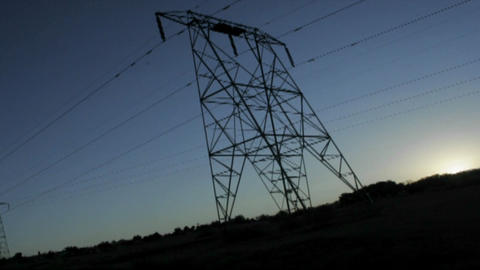 High tension lines against the rising sun Stock Video Footage