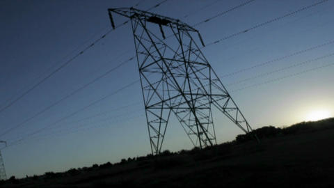 High tension lines against the rising sun Footage