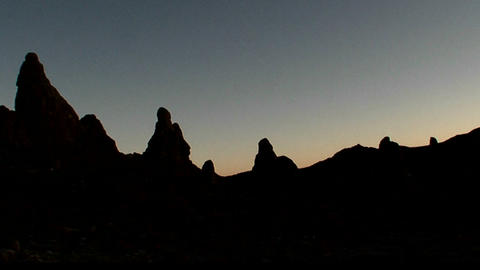 The Trona Pinnacles are silhouetted against the dawn Stock Video Footage