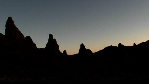 The Trona Pinnacles are silhouetted against the dawn Footage