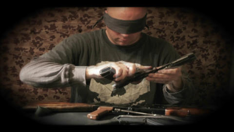 A time lapse shot of an assassin putting together a gun Stock Video Footage