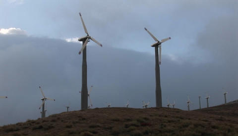 Windmills generate power on a hillside in california Footage