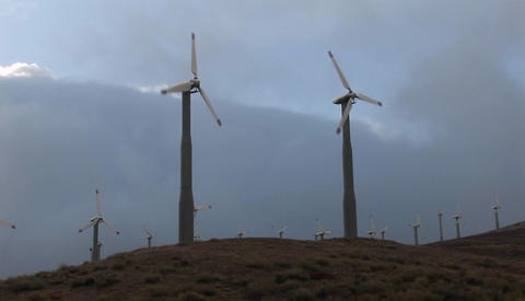 Windmills generate power on a hillside in california Stock Video Footage