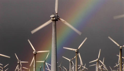 Gorgeous rainbows illuminate wind powered generators... Stock Video Footage