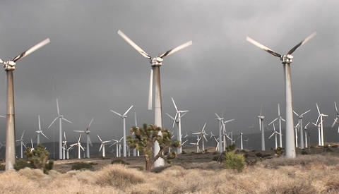 Pan across windmill generating electrical power on a... Stock Video Footage