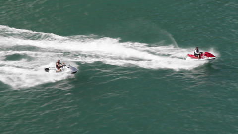 Two jet skis race across the water Stock Video Footage