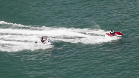 Two jet skis race across the water Footage