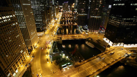 Cars driving through Chicago at night Stock Video Footage