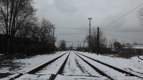 A person crosses a railway line on a bicycle Stock Video Footage