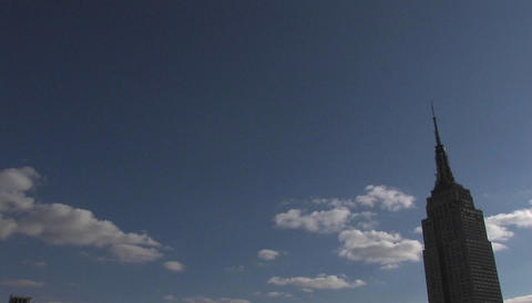 High clouds pass the Empire State building Stock Video Footage