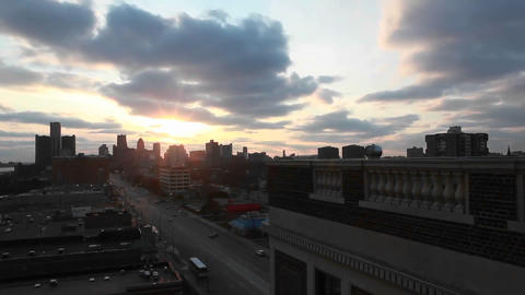 Time lapse of clouds passing over cars traveling in the city Stock Video Footage