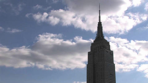 Clouds roll pass the Empire State Building Stock Video Footage