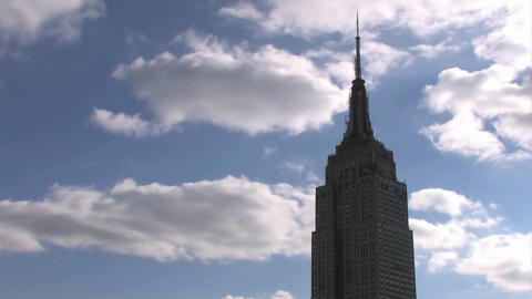 Clouds roll pass the Empire State Building Footage