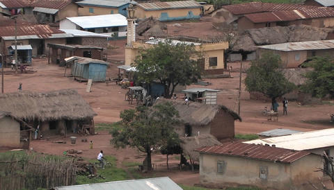 The people of a small African village go about their... Stock Video Footage
