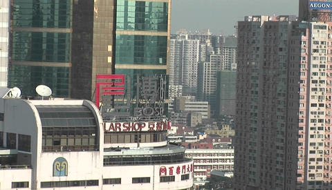 Aerial shot, zooming out on an Asian city Stock Video Footage