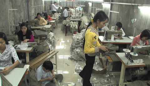 Women in a small factory sewing clothes Footage