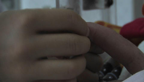 Nurse taking care of a new born baby in birth center in a... Stock Video Footage
