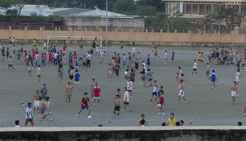 Boys in a school yard playing soccer Stock Video Footage