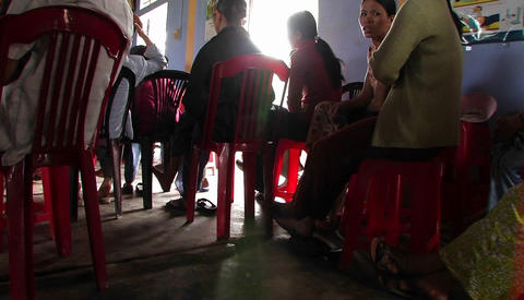 A woman addresses a group of people in a classroom in... Stock Video Footage