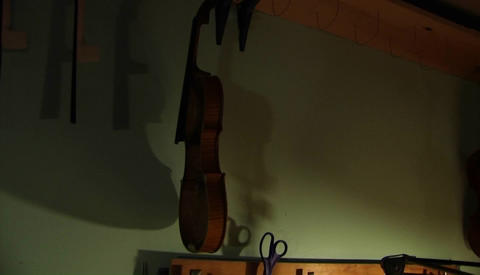 A man making a violin Stock Video Footage
