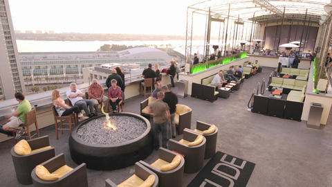 Time-lapse of a rooftop nightclub filling up for t Stock Video Footage