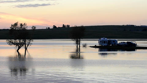 Campers watching the sunset from their RV at Far W Stock Video Footage