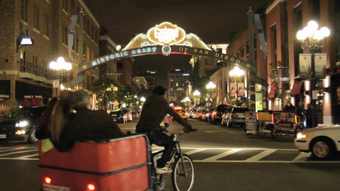 Pedicab peddling tourists in downtown San Diego at Footage