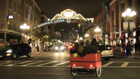 Pedicab peddling tourists in downtown San Diego at Stock Video Footage