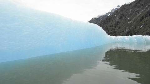 Close up tracking motion from a boat of an iceberg Stock Video Footage