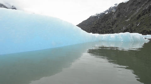 Close up tracking motion from a boat of an iceberg Footage
