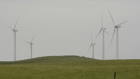 Wind turbines generating electricity on Highway 12 Stock Video Footage