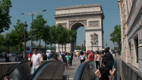 The Arc De Triumphe in paris with pedestrians Stock Video Footage