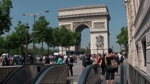 The Arc De Triumphe in paris with pedestrians Stock Video Footage
