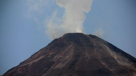 An active volcano bilious smoke and ash Footage