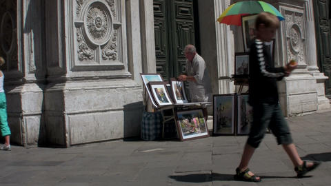 A street artist paints outside a cathedral in Pari Footage