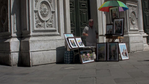 A street artist paints outside a cathedral in Pari Stock Video Footage