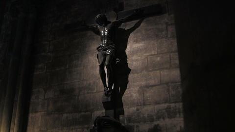 A spooky scene of Jesus on cross from a darkened c Stock Video Footage