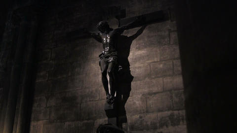 A spooky scene of Jesus on cross from a darkened c Footage